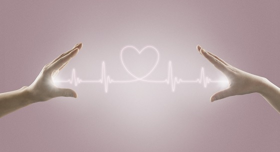 2 hands with heart beat line and heart symbol
