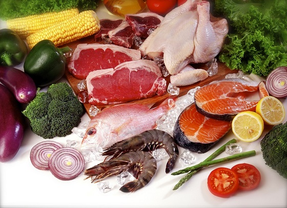 health food including meat and dark leafy green vegetables
