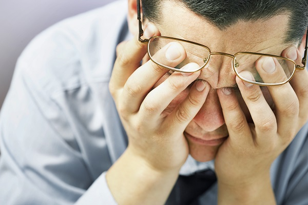 a stressed man hearing news of visceral fat