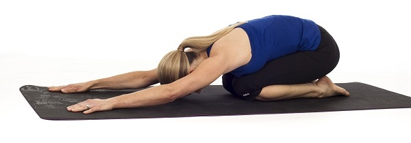 a lady in the yoga child's pose