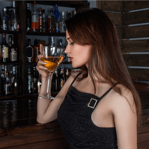 young lady drinking wine