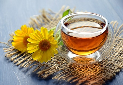 a cup of daisy tisanes tea flavour