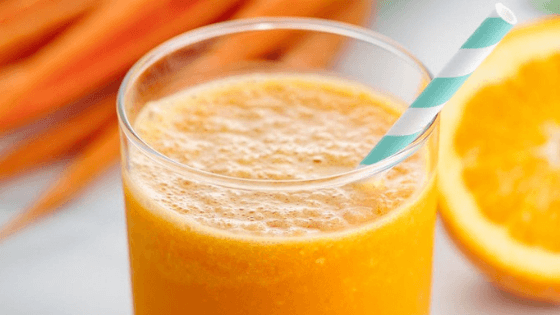 an orange, ginger, carrot and turmeric juice