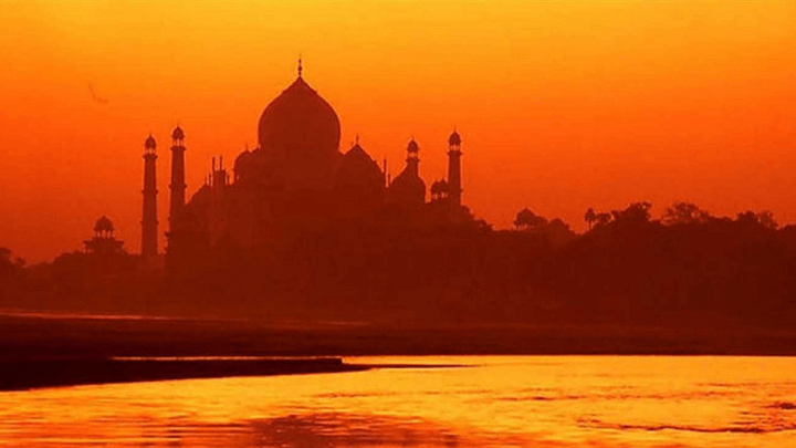 an Indian mosque in an orange sunset