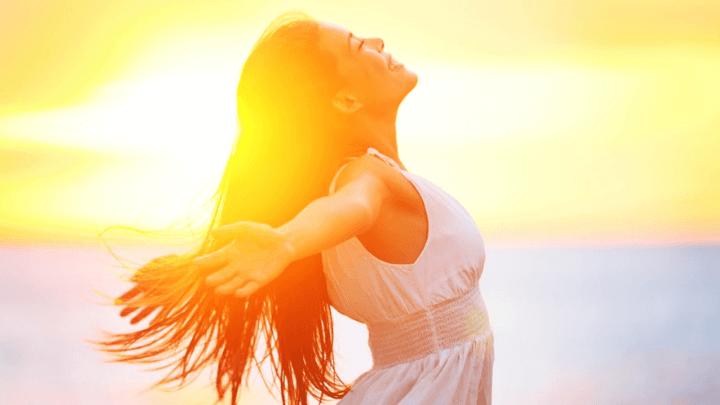 a lady enjoying the sunshine and soaking up vitamin d