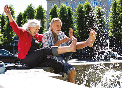 Healthy couple kicking in a fountain