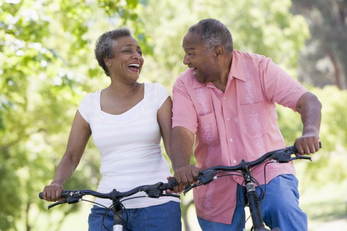 active elderly couple on bicycles