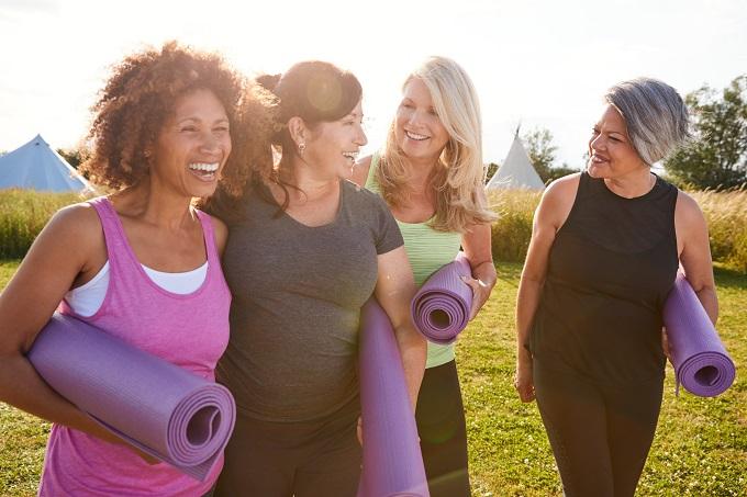 women preparing to do yoga
