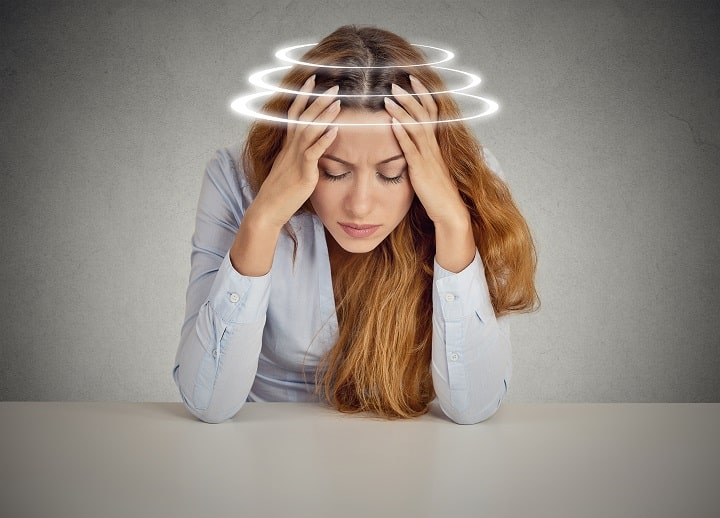 Woman suffering from dizziness assiciated with menopause