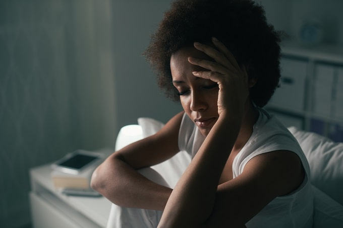 Woman experiencing a migraine from the menopause