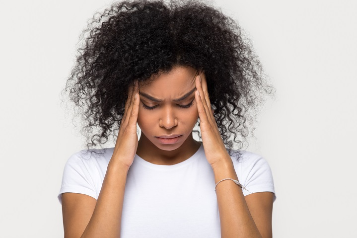 woman suffering from a headache caused by the menopause