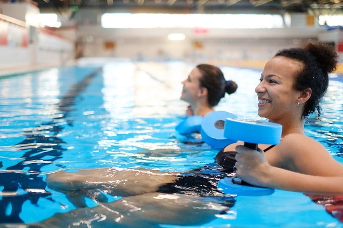 Women in an aqua aerobics class to prevent joint pain caused by menopause