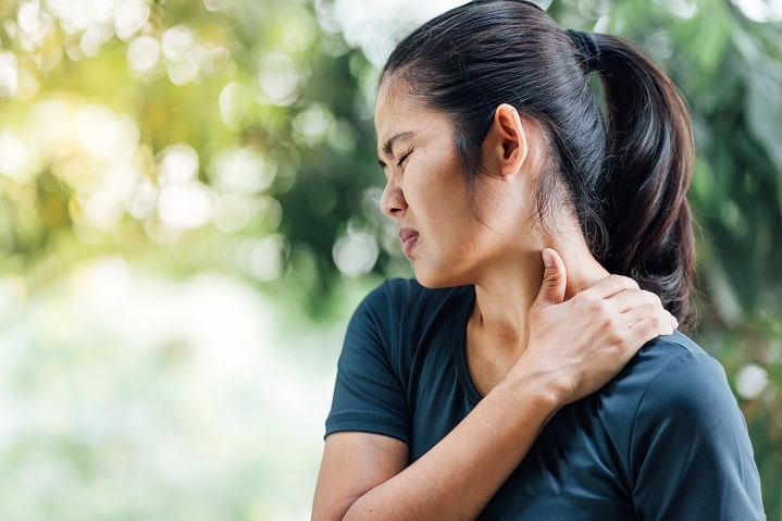 woman suffering joint pain caused by the menopause