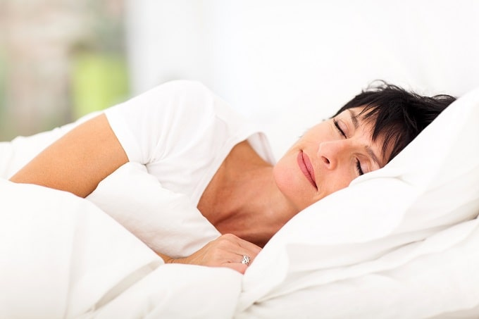Woman getting a good nights sleep to combat joint pain caused by menopause