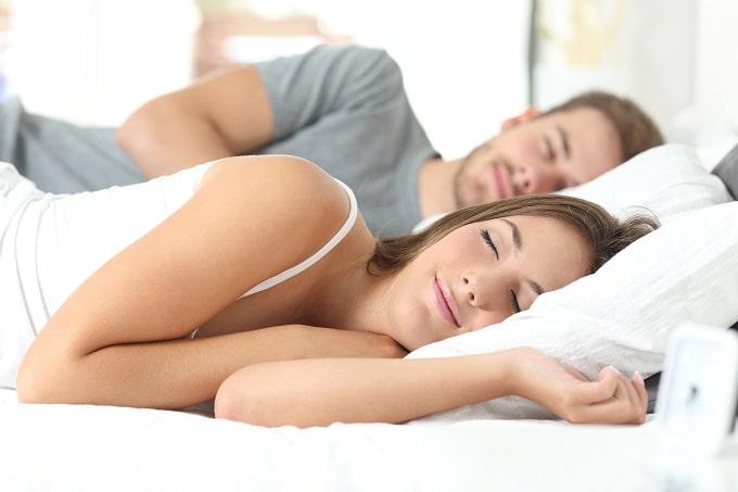 couple sleeping well