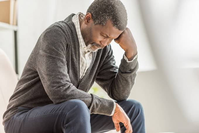 Symptoms of male menpause can include depression and fatigue